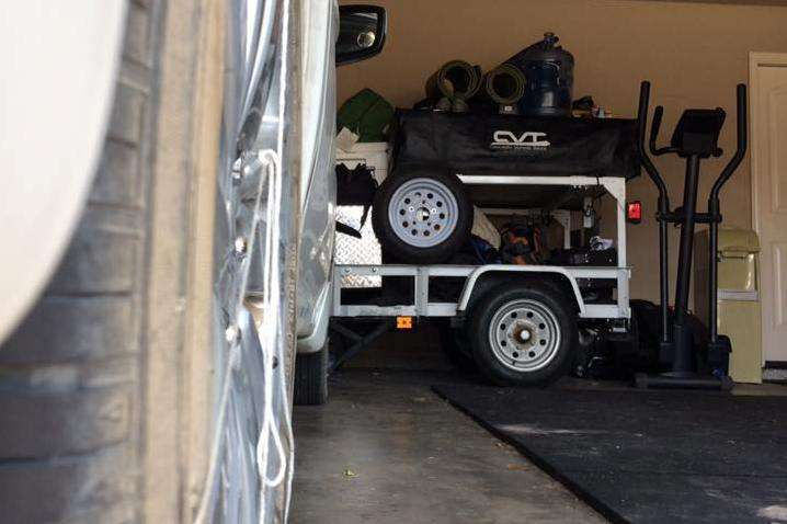 compact camping trailer stored in garage with the Subaru