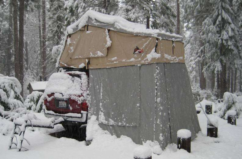 Compact Camping Trailers - Roof Top Tent on Vehicle in Snow